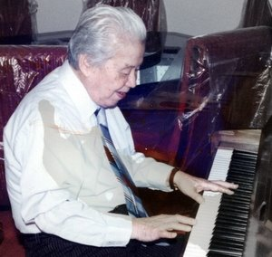 [photo of grandfather at piano]